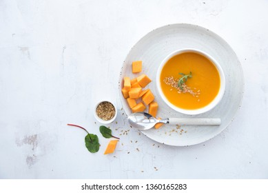 pumpkin soup on a white table. top view
