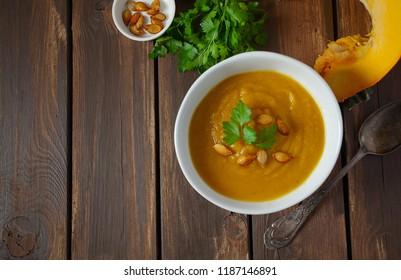 pumpkin soup on wooden surface