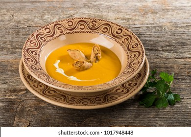 Pumpkin soup on the wooden table