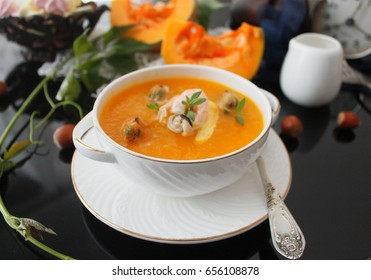 Pumpkin soup with seafood
