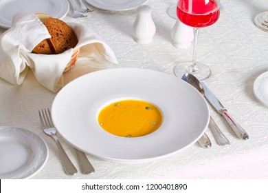 Pumpkin soup with seeds and rye bread