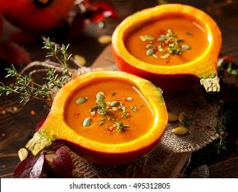 Pumpkin soup served in a hollowed pumpkins