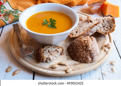 Pumpkin soup with pumpkin slices and bread