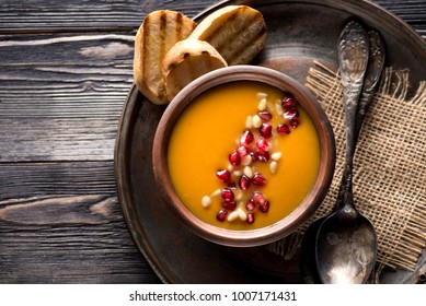 Pumpkin soup and toast of white bread, top view