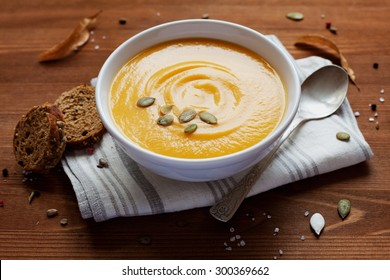 Pumpkin soup in white bowl, dietary vegetable food