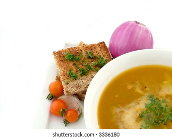 Pumpkin soup with wholemeal bread and cherry tomatoes