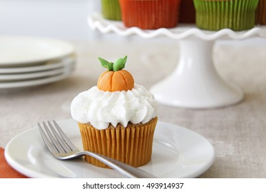 Pumpkin spice cupcake with vanilla buttercream decorated for Halloween and Thanksgiving