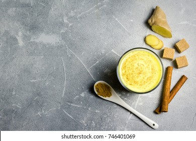 Pumpkin spice golden turmeric milk on stone background. Top view, copy space.