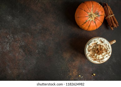 Pumpkin Spice Latte. Cup of Latte with Seasonal Autumn Spices, top view, copy space. Traditional Coffee Drink for Autumn Holidays.