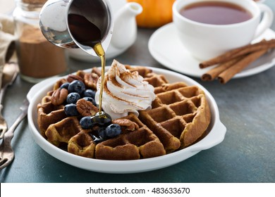 Pumpkin spicy waffles with whipped cream for breakfast
