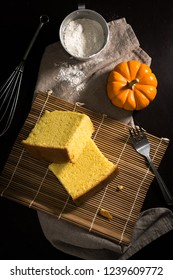 Pumpkin sponge cake in dark background