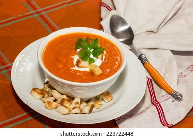 pumpkin squash soup with parsley and soup creame and croutons