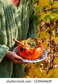 Pumpkin Stuffed with Pasta, Cheese and Meat.outdoor photo.selective focus