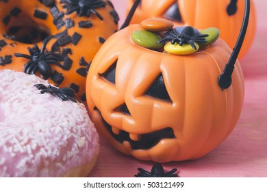 pumpkin stuffed with Smarties and donuts halloween