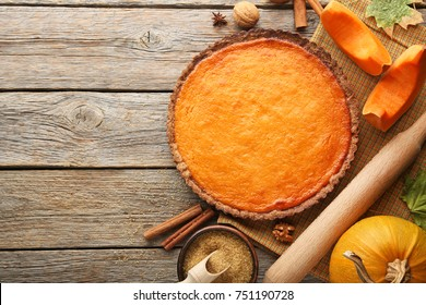 Pumpkin tart with cinnamon and sugar on wooden table