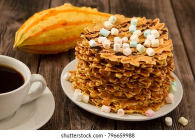 Pumpkin waffles on wooden background