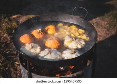 Pumpking boiling in metal pot outdoor
