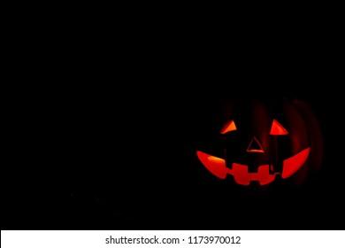 Pumpking iluminated on the darkness. Halloween cocept