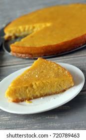 Pumpking pie on grey wooden desk. Homemade pie. Thanksgiving dinner
