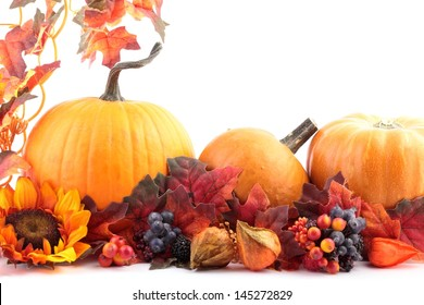 Pumpkins and autumn decorations on white background with copy space.