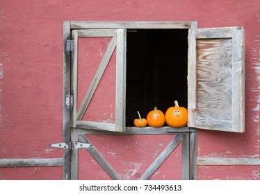 Pumpkins in barn window