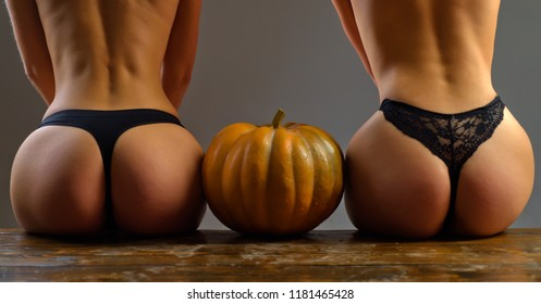 Pumpkins with big ass. Female with sexy ass posing. Womens clothing store celebrates Halloween. Pumpkin with sexy ass. Halloween sexy concept