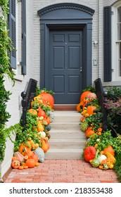 Pumpkins decorated Halloween ready front door