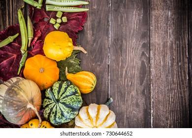 Pumpkins decoration on wooden table / Halloween - Thanksgiving - Autumn concept