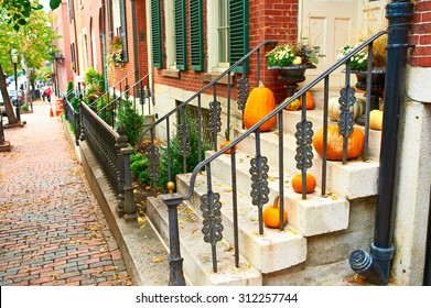 Pumpkins near the door during Halloween season