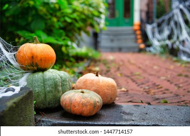 Pumpkins on the steps at the house. Halloween decorations outside. residence front entrance on Halloween. creepy decorations. Copy space for your text