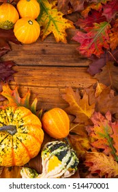 pumpkins on a table with autumn leaves