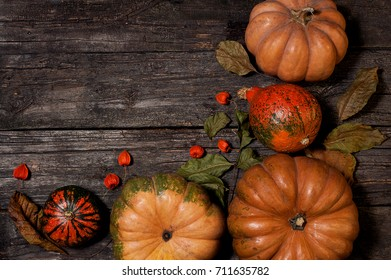 Pumpkins on the wooden desk wish leaves. Idea for Halloween