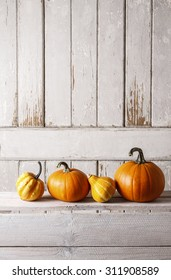 Pumpkins on wooden table, copy space