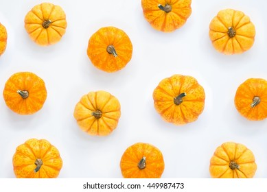Pumpkins patterned over white background, top view