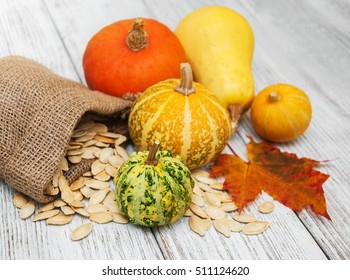 Pumpkins and seed on a old wooden table