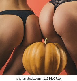 Pumpkins with sexy asses. Female with sexy ass posing. Copy space for text. Halloween poster with sexy pumpkins. Pumpkins with sexy ass