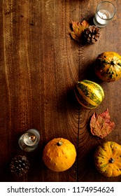 Pumpkins,candle light and autumn leaves