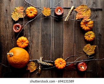 Pumpkins,candles and autumn leaves.frame