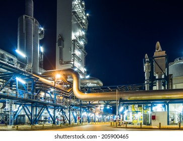 pumps and piping system at night