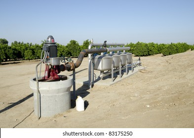 Pumps, valves and filters control the irrigation system in a Central California orange grove
