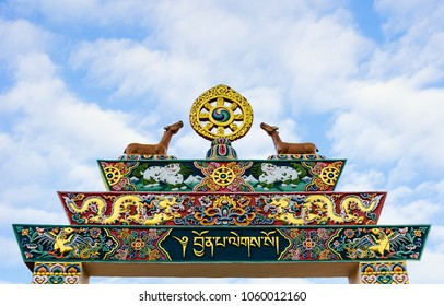 Punakha / Bhutan -  10 16 2016: Traditional Bhutanese Art – Detail of the wedding-gate built on the occasion of the king's wedding. A craftwork full of buddhist symbolism beside Punakha Dzong.