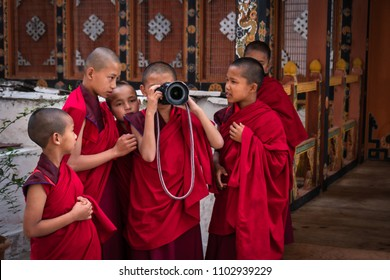 Punakha, Bhutan - April 1, 2018 : Novice monks, still boys, very curious getting to know my friend's camera