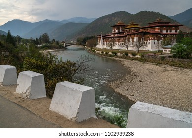 Punakha, Bhutan - April 1, 2018 : The Punakha Dzong in the late afternoon seen from the road with the river in front of it