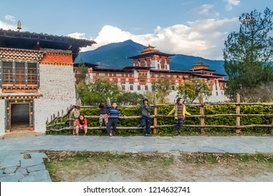 Punakha/ Bhutan - February 27, 2016 Bhutan children on the background of Punakha Dzong Monastery, one of the largest monastery in Asia, Punakha, Bhutan