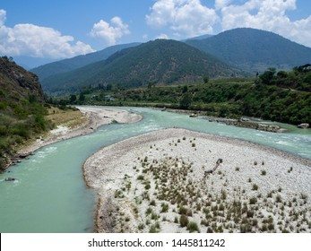 Punakha, Bhutan - May 14 2019: where the male and females rivers meet near Punakha Dzong, Bhutan