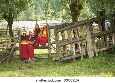 PUNAKHA BHUTAN SEPTEMBER 28 2012 :  Bhutanese monks sitting at monastery near  Punakha Dzong  in Bhutann