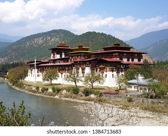 Punakha district/ Bhutan - March 15 2019: The second largest and oldest of Punakha Dzong in Bhutan, view from the opposite of two rivers, named as Mo Chhu and Po Chhu.