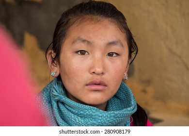 PUNAKHA DISTRICT, BHUTAN - SEP 10, 2014: An unidentified local Bhutanese girl with brown eyes look at camera, on September 10, 2014 in Punakha, Bhutan.
