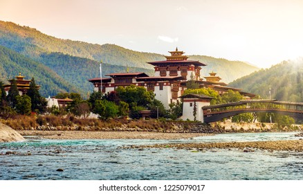 Punakha Dzon at sunset, with sunrays reacjing over the hill