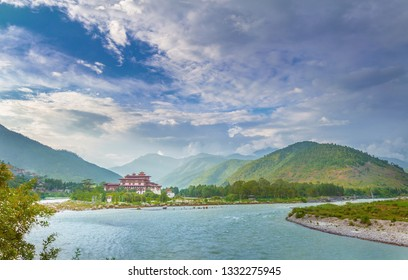 Punakha Dzong Monastery view from far away, one of the largest monestary by the river on a nice weather day, Punakha, Bhutan